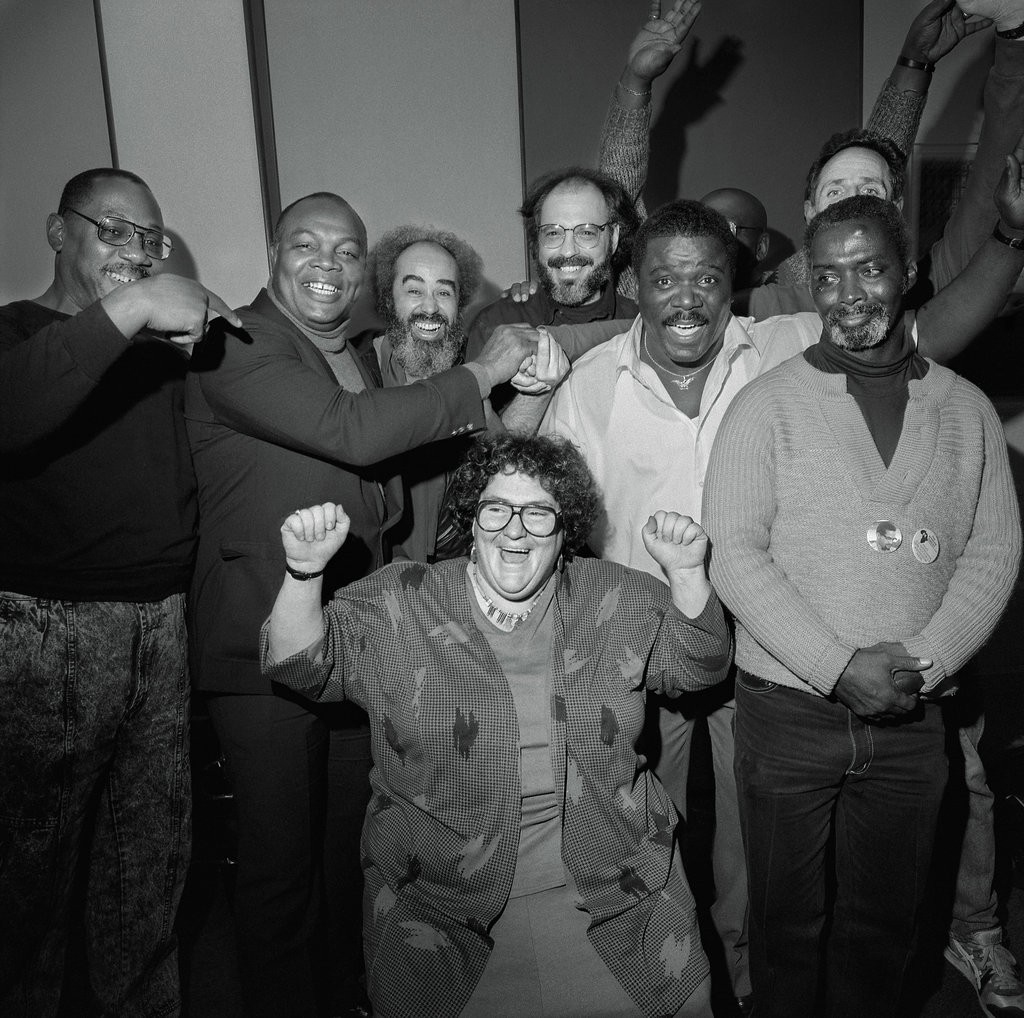 Elizabeth Fink with Attica clients in 1991. Credit Photograph by Larry Fink