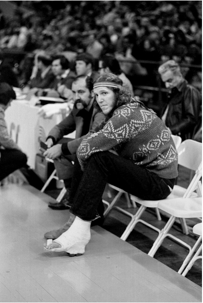 Walton watching his Portland Trail Blazers play in 1975, his foot immobilized by an injury. Bettman/Getty Images