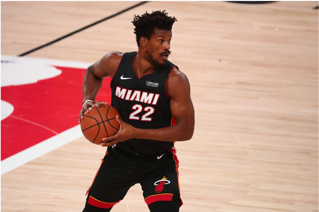 Miami Heat forward Jimmy Butler (22) controls the ball against the Boston Celtics during the first half of game three of the Eastern Conference Finals of the 2020 NBA Playoffs at ESPN Wide World of Sports Complex. Kim Klement, USA TODAY Sports/Reuters