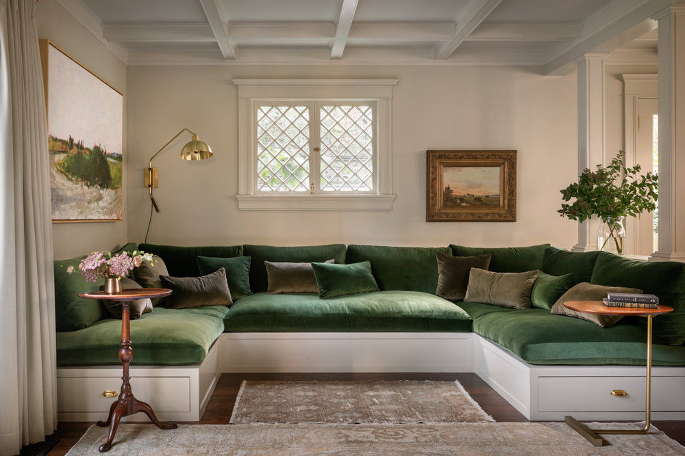 """The family room is anchored by a built-in sofa, big enough to comfortably fit the clients and their two children, topped with plush cushions in a sumptuous green velvet."" Photography by Aaron Leitz, courtesy of Jessica Helgerson Interior Design."