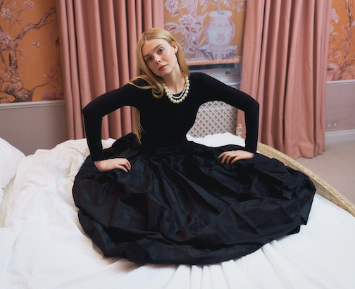 Fanning wears a Wolford bodysuit; Carolina Herrera skirt; necklaces, from top: stylist's own, Ben-Amun by Isaac Manevitz. Photographed by Zoë Ghertner. Courtesy of W Magazine.