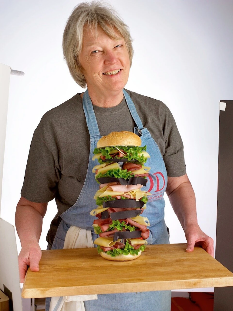 The food stylist Delores Custer in an undated photo. Her sandwiches were architectural marvels, her builds — to use the industry term of art — the envy of her peers. Credit...Colin Cooke, NY TIMES